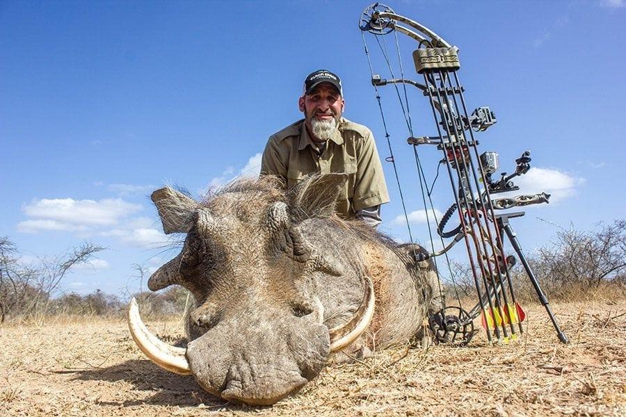 Matt with a warthog