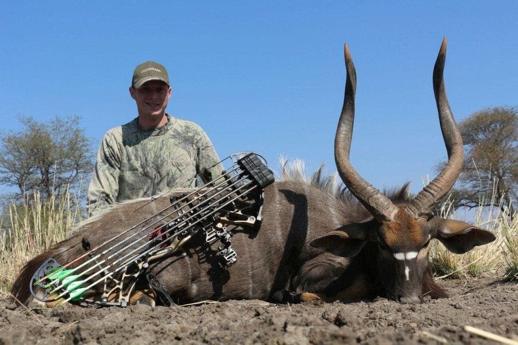 image of South Africa Troy Hawkins with a Nyala