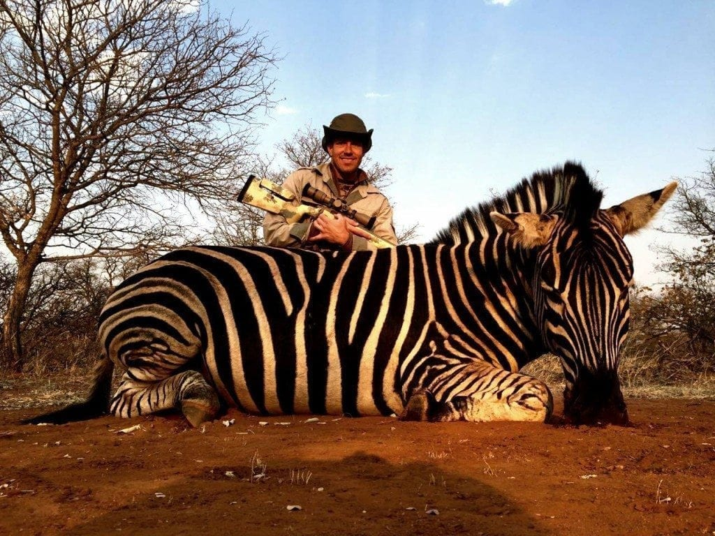 Jason Zuhlke in South Africa with his Zebra taken at Doornrand Hunting Safaris