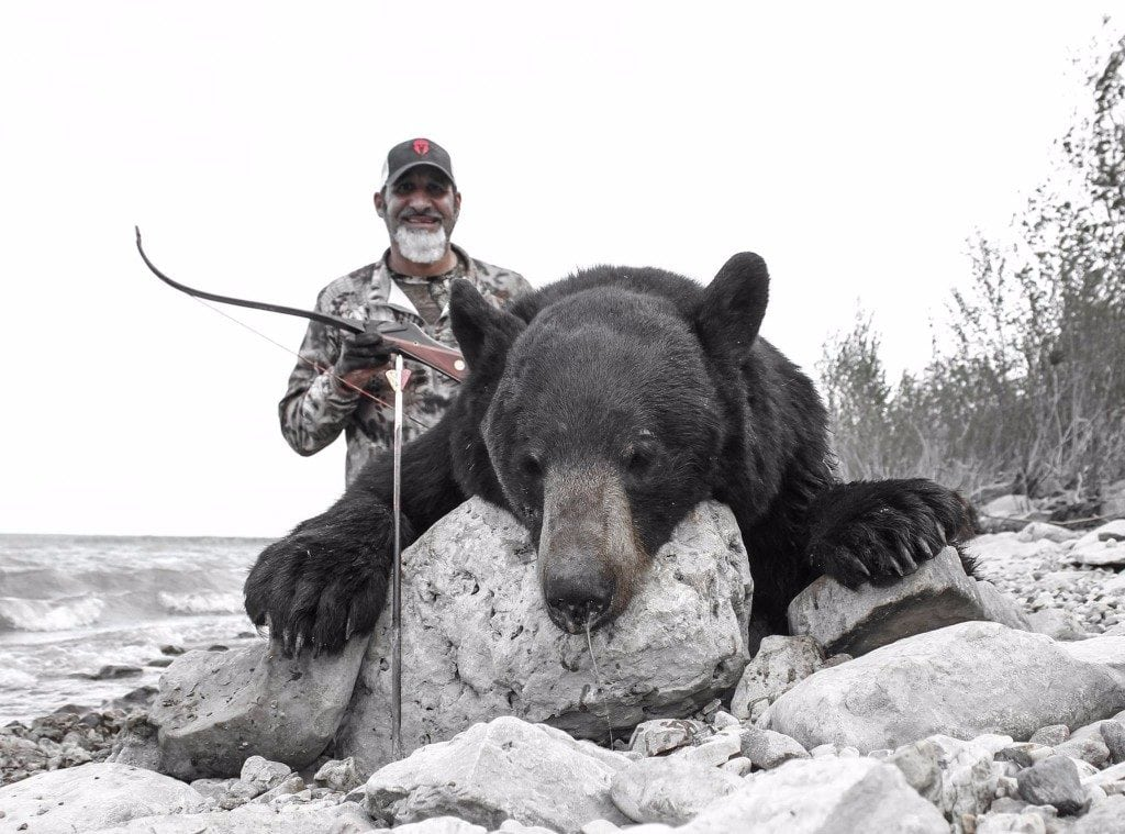 Matt Guedes with a Bear annd a Bow