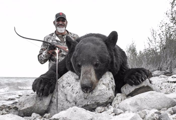 picture of a Bear with Matt Guedes and a Recurve Bow